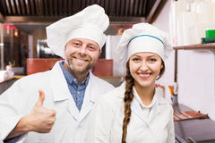 Chef and his helper at bistro kitchen Stock Image