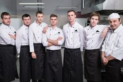 Chef restaurant teamwork professional staff. Chef and his team of professional staff at restaurant. Teamwork brings success to any business royalty free stock images
