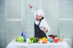Chef hold cleaver knife tool ready to chop ingredients. Man wear apron cooking in kitchen. Man use sharp cleaver knife. Types of knives. Sharp knife stock image