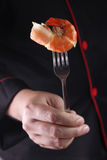 Chef hold fork with big shrimp Stock Photo