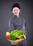 Chef holding a basket of delicious fresh vegetables Stock Image