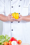 Chef holding bell peper Stock Image
