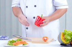 Chef holding bell peper Stock Photo