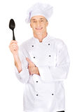 Chef holding black plastic spoon Royalty Free Stock Photography