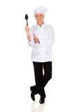 Chef holding black plastic spoon Stock Image