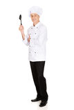 Chef holding black plastic spoon Royalty Free Stock Images