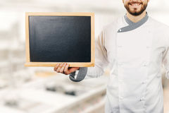 Chef holding blank blackboard in hand Stock Photography