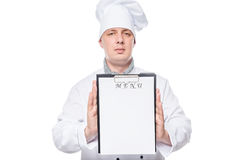 Chef holding blank close-up sheet for the menu recording Royalty Free Stock Photos