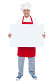 Chef holding blank white billboard Stock Images