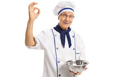 Chef holding a bowl and making an ok sign Stock Photos