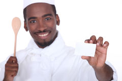 Chef holding business card Royalty Free Stock Photos