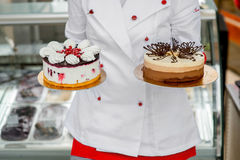Chef holding cakes Stock Images