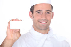Chef holding a call card Royalty Free Stock Image