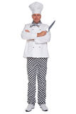 Chef holding carving knife isolated. Photo of a chef in uniform with his arms folded holding a knife isolated on a white background royalty free stock photo