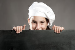 Chef holding chalkboard. Young chef holding menu chalkboard Royalty Free Stock Image
