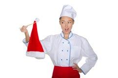 Chef Holding Chopsticks Christmas Cap Royalty Free Stock Photos