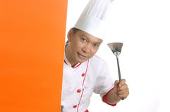 Chef holding cooking utensils. Isolated on white background Stock Image