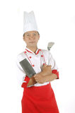 Chef holding cooking utensils. Isolated on white background Stock Photo