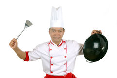 Chef holding cooking utensils. Isolated on white background Stock Photography