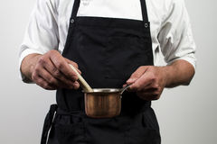 Chef holding copper pan Royalty Free Stock Images