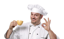 Chef holding cup. Stock Photography