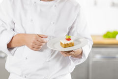 Chef holding dessert cake with strawberry Stock Photography