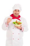 Chef  holding dish with salad and fresh vegetables  wearing red Stock Images