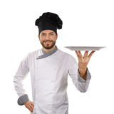 Chef holding empty dish isolated on white Royalty Free Stock Photography