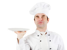 Chef holding empty plate Stock Image
