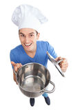Chef holding empty pot Royalty Free Stock Image