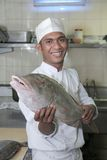 Chef holding fish at butcher Stock Photos