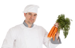 Chef holding fresh carrots Royalty Free Stock Photo