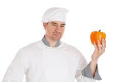 Chef holding fresh pepper Stock Photo