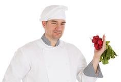 Chef holding fresh radish Stock Photography