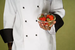 Chef Holding fresh Strawberries in Bowl Stock Images