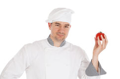 Chef holding fresh tomato Stock Photography