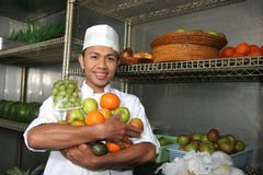 Chef holding fruits. Photograph of chef holding fruits stock photos