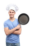 Chef holding frying pan Stock Images