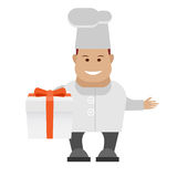 Chef holding gift box Stock Images