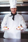 Chef holding his dish Royalty Free Stock Image