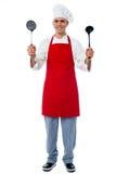 Chef holding kitchen essentials Stock Photo