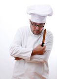 Chef holding a kitchen knife Royalty Free Stock Image