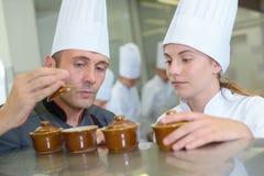 Chef holding lid ramekin pot Stock Photography