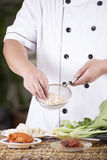 Chef holding the noodle to colander before cooking Royalty Free Stock Photos
