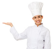 Chef Holding Out Invisible Product Royalty Free Stock Photos