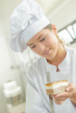 Chef holding piece cake Stock Images