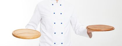 Chef holding pizza desk on white background isolated,blank,copy space royalty free stock photo