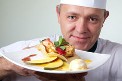 Chef holding plate cheese fruit dessert Stock Photos