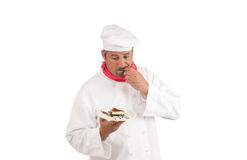 Chef holding plate of cheesecake Royalty Free Stock Photos