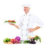 Chef holding plate with fresh vegetables Stock Image